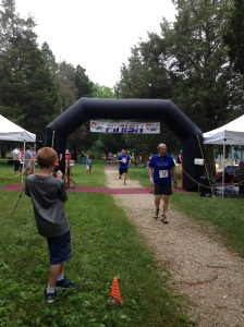 Crossing the Finish Line (that is me in the background)